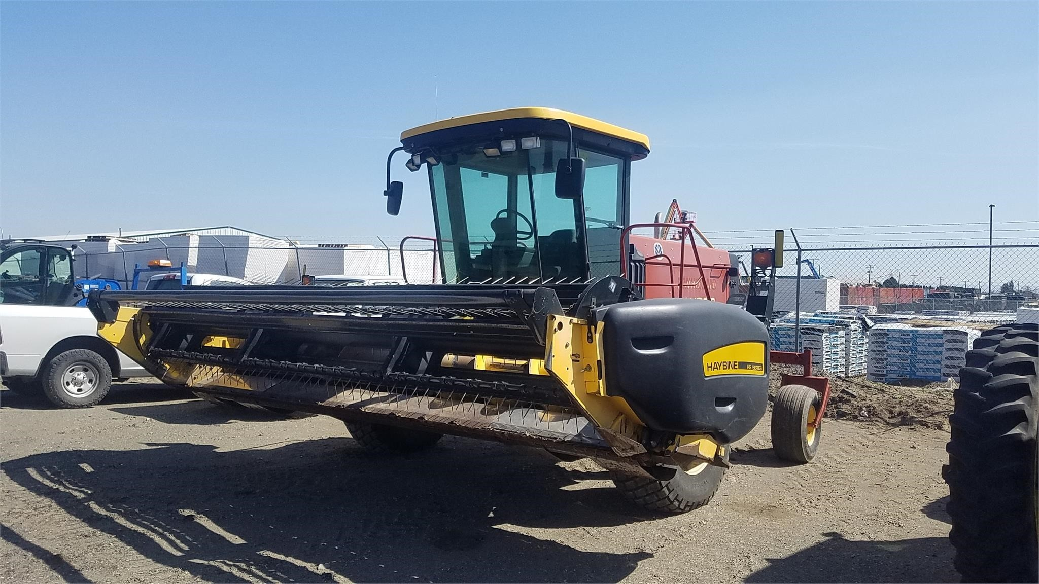 2004 New Holland HW320 Self-Propelled Windrowers and Swather
