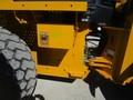 2012 Deere 624 Backhoe and Excavator Attachment