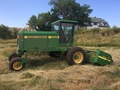 2000 John Deere 4890 Self-Propelled Windrowers and Swather
