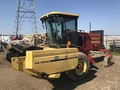 1997 New Holland 2450 Self-Propelled Windrowers and Swather