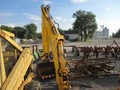 New Holland 75B Backhoe and Excavator Attachment