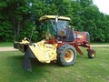 2009 New Holland H8080 Self-Propelled Windrowers and Swather