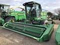 2009 John Deere 4895 Self-Propelled Windrowers and Swather