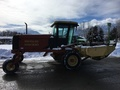 1999 New Holland HW300 Self-Propelled Windrowers and Swather