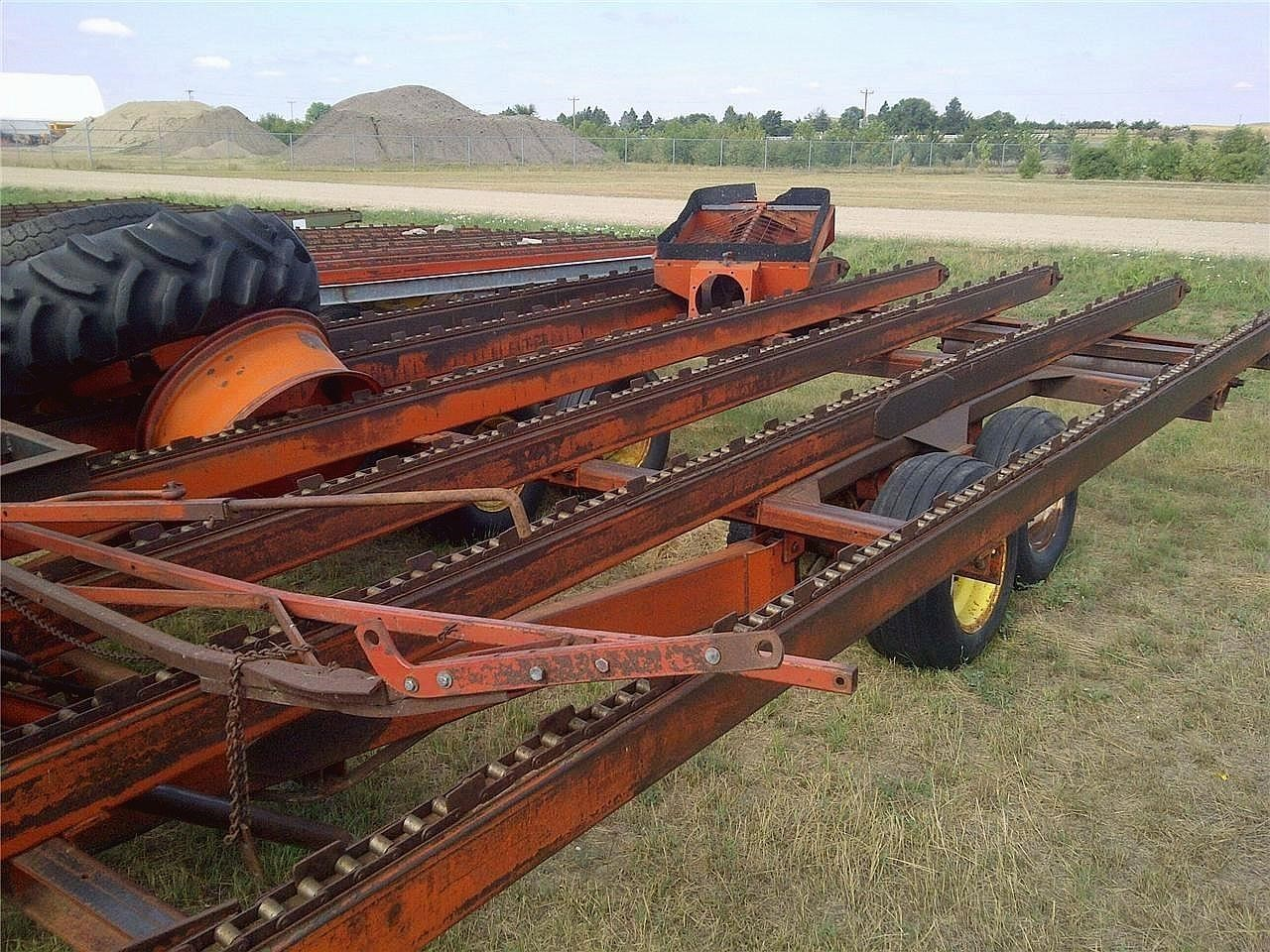 1984 Farmhand 12x24 Bale Wagons and Trailer