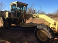 1995 Caterpillar 120G Compacting and Paving